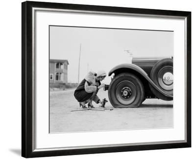 Woman Changing Flat Tire on Car-H^ Armstrong Roberts-Framed Photographic Print
