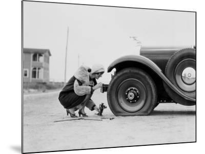 Woman Changing Flat Tire on Car-H^ Armstrong Roberts-Mounted Photographic Print