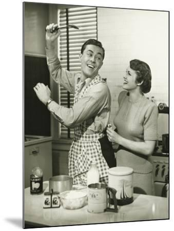 Young Cheerful Couple in Kitchen, Man in Apron-George Marks-Mounted Photographic Print