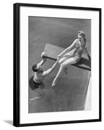 Woman Sitting on Diving Board, Man Grasping Her Hand-George Marks-Framed Photographic Print