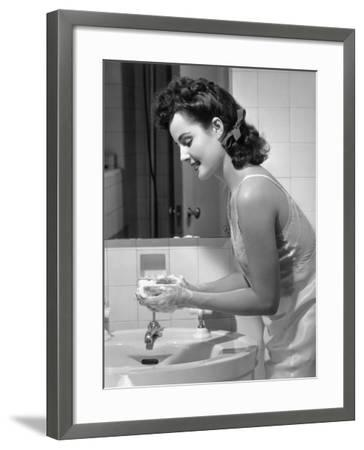 Woman Washing Hands at Bathroom Sink-George Marks-Framed Photographic Print