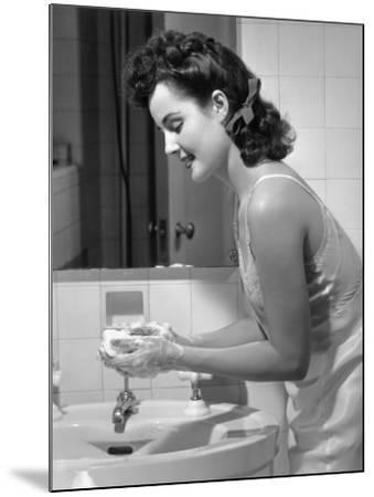 Woman Washing Hands at Bathroom Sink-George Marks-Mounted Photographic Print
