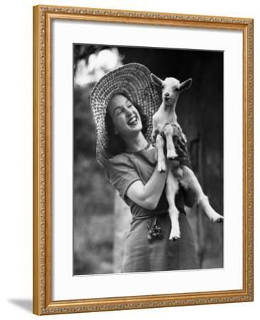 Woman Laughing and Holding a Goat-George Marks-Framed Photographic Print