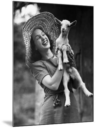 Woman Laughing and Holding a Goat-George Marks-Mounted Photographic Print