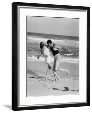 Couple Embracing on Sandy Beach-H^ Armstrong Roberts-Framed Photographic Print