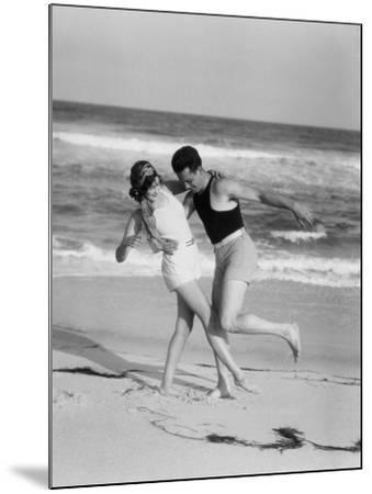 Couple Embracing on Sandy Beach-H^ Armstrong Roberts-Mounted Photographic Print