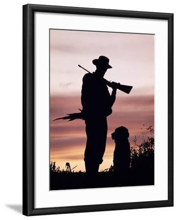 Silhouette of Man Hunter, Holding Rifle or Gun, Wearing Cowboy Hat-H^ Armstrong Roberts-Framed Photographic Print
