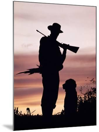Silhouette of Man Hunter, Holding Rifle or Gun, Wearing Cowboy Hat-H^ Armstrong Roberts-Mounted Photographic Print