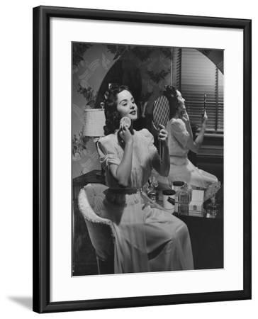 Woman Applying Make Up at Vanity Table-George Marks-Framed Photographic Print