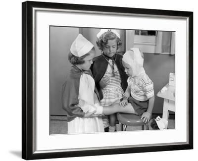 Two Young Girls Dressed As Nurses, Bandaging Three Year Old Boy's Head and Foot-H^ Armstrong Roberts-Framed Photographic Print