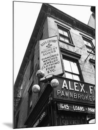 Comerical Sign at Building Corner, Low Angle View-George Marks-Mounted Photographic Print