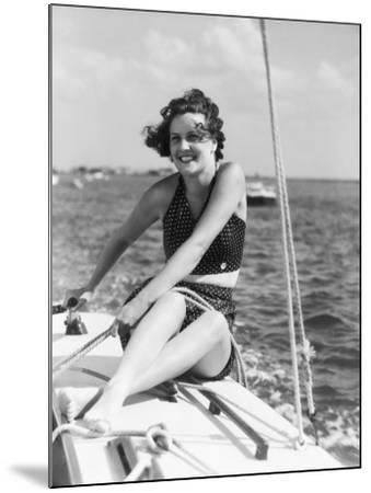 Woman in Swimsuit, on Sailing Boat, Holding Rope, Smiling-H^ Armstrong Roberts-Mounted Photographic Print