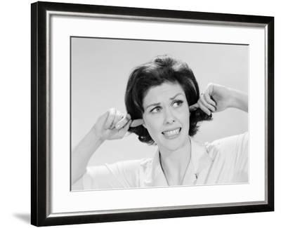 Woman Sticking Fingers in Her Ears-H^ Armstrong Roberts-Framed Photographic Print