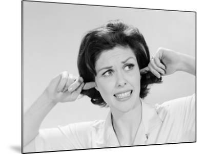 Woman Sticking Fingers in Her Ears-H^ Armstrong Roberts-Mounted Photographic Print