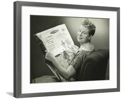 Woman Sitting in Armchair, Reading Newspaper, Smiling-George Marks-Framed Photographic Print