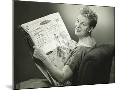 Woman Sitting in Armchair, Reading Newspaper, Smiling-George Marks-Mounted Photographic Print