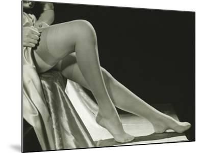 Woman Pulling on Stockings, Low Section-George Marks-Mounted Photographic Print