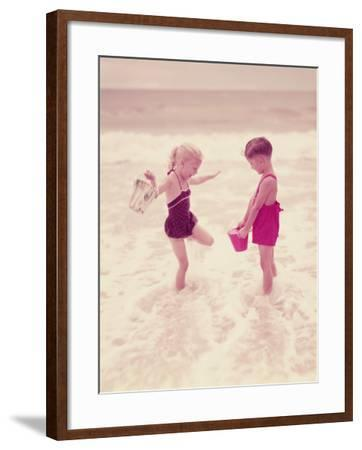 Boy and Girl Playing in Ocean Surf-H^ Armstrong Roberts-Framed Photographic Print