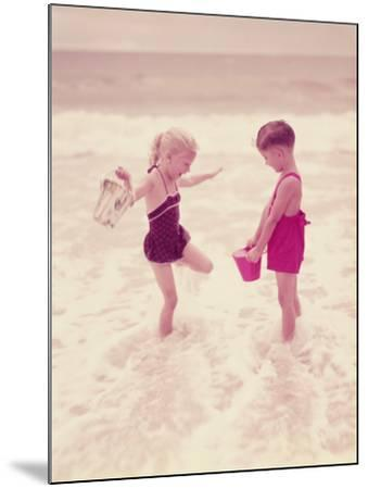 Boy and Girl Playing in Ocean Surf-H^ Armstrong Roberts-Mounted Photographic Print