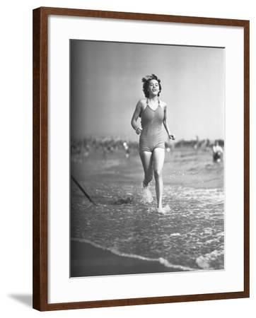 Woman in Swimsuit Running on Shoreline-George Marks-Framed Photographic Print