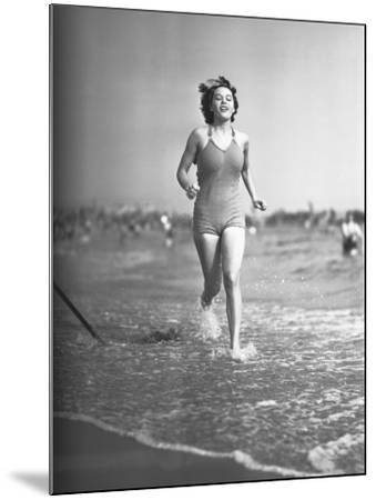 Woman in Swimsuit Running on Shoreline-George Marks-Mounted Photographic Print