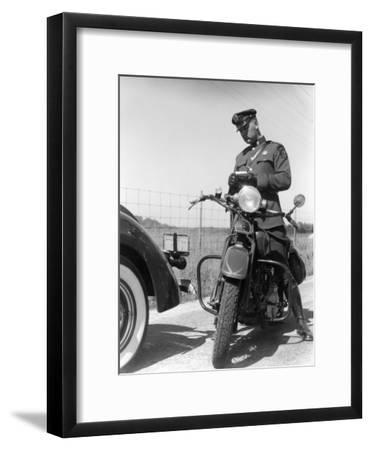 Policeman on a Motorcycle Writing a Ticket-H^ Armstrong Roberts-Framed Photographic Print