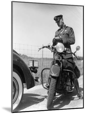 Policeman on a Motorcycle Writing a Ticket-H^ Armstrong Roberts-Mounted Photographic Print