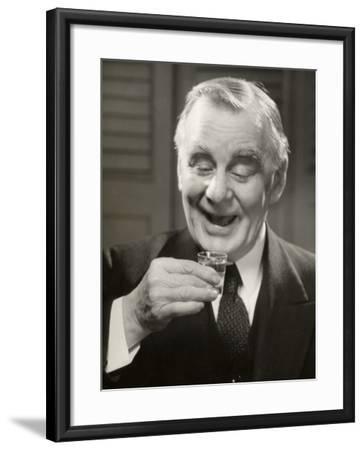 Elderly Man Raising Glass of Whiskey-George Marks-Framed Photographic Print