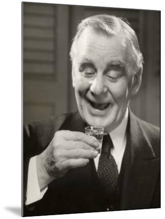 Elderly Man Raising Glass of Whiskey-George Marks-Mounted Photographic Print