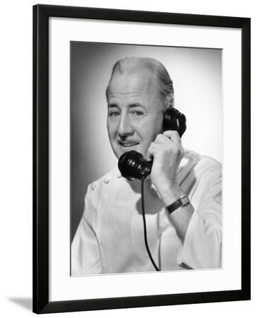 Doctor on the Telephone-George Marks-Framed Photographic Print