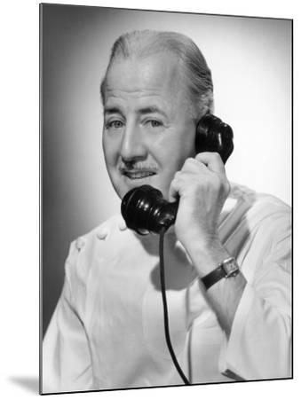 Doctor on the Telephone-George Marks-Mounted Photographic Print