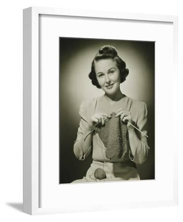 Young Woman Knitting in Studio, Portrait-George Marks-Framed Photographic Print
