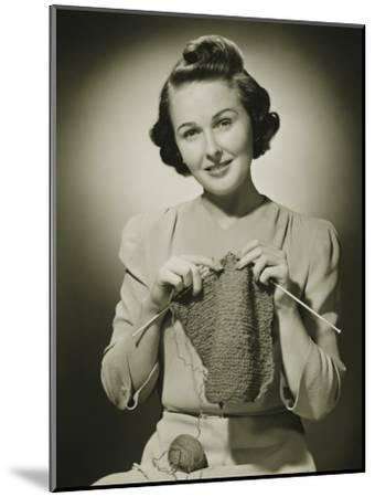 Young Woman Knitting in Studio, Portrait-George Marks-Mounted Photographic Print