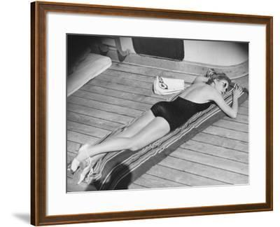 Young Woman Sun Tanning on Cruiser Deck-George Marks-Framed Photographic Print
