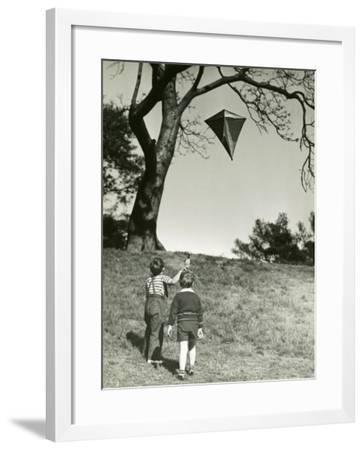 Small Boys Flying Kite-George Marks-Framed Photographic Print