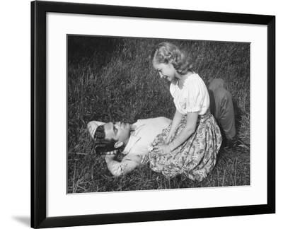 Young Couple Resting on Lawn-George Marks-Framed Photographic Print