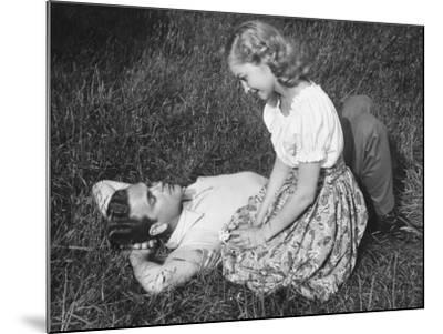 Young Couple Resting on Lawn-George Marks-Mounted Photographic Print