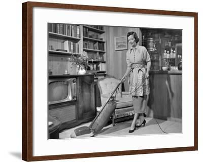 Apron Housewife Vacuuming Den-George Marks-Framed Photographic Print