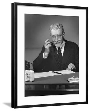 Doctor Sitting in Office-George Marks-Framed Photographic Print