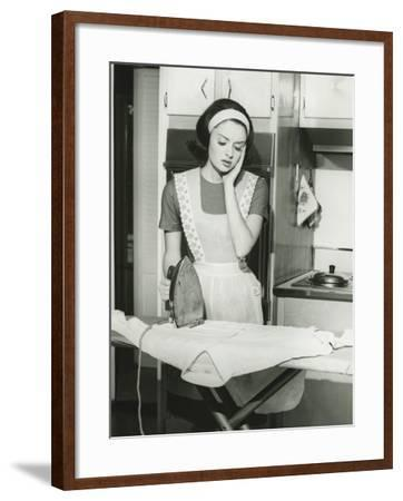 Young Woman Ironing in Kitchen-George Marks-Framed Photographic Print