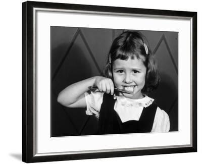 Little Girl Brushing Her Teeth-George Marks-Framed Photographic Print
