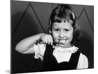 Little Girl Brushing Her Teeth-George Marks-Mounted Photographic Print