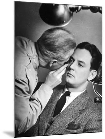 Doctor Examining Patient's Eyes-George Marks-Mounted Photographic Print