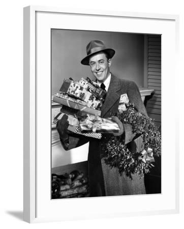 Man With Christmas Gifts-George Marks-Framed Photographic Print