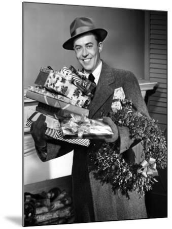 Man With Christmas Gifts-George Marks-Mounted Photographic Print
