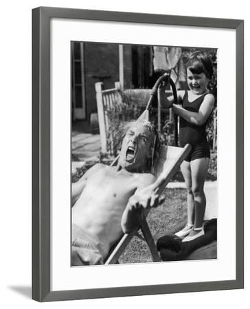 Hosing Down Dad--Framed Photographic Print