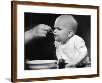 Baby Being Fed-George Marks-Framed Photographic Print