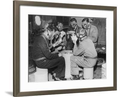 Group of Men Playing Cards, Wearing Gas Masks--Framed Photographic Print