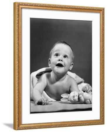 Baby Wrapped in Blanket, Holding Toy Rabbit--Framed Photographic Print