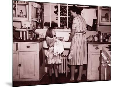 Mother and Daughter (8-10) Washing and Wiping Dishes--Mounted Photographic Print